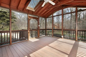 Porch in suburban home with wood beams and skylight